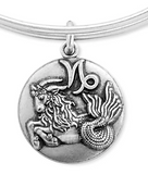 Zodiac jewelry designed by Emily Lopuch for Alex and Ani.