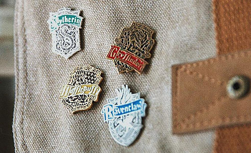 Harry Potter house pins designed by Emily Lopuch for Alex and Ani and Warner Bros.