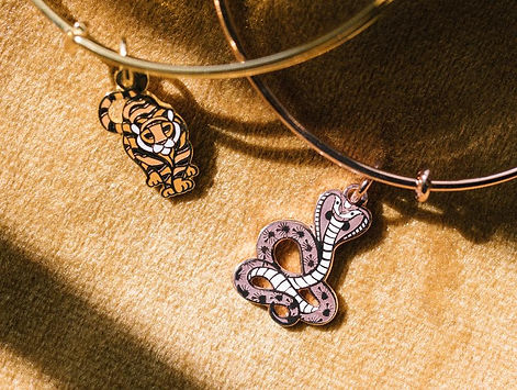 Tiger and Cobra jewelry designed by Emily Lopuch for Alex and Ani.