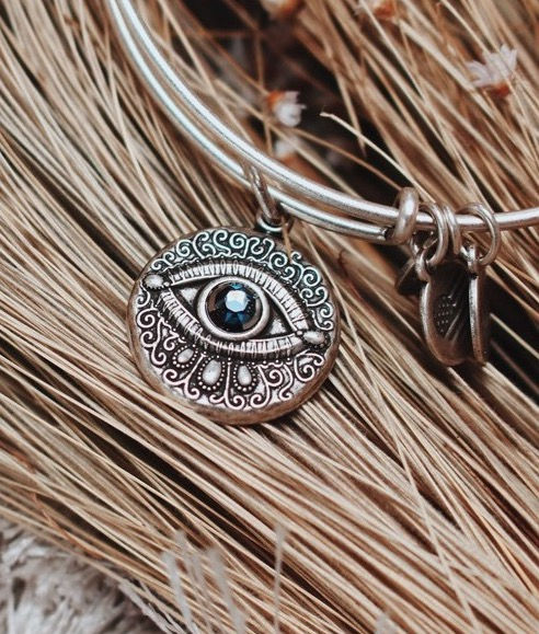 Meditating Eye jewelry designed by Emily Lopuch for Alex and Ani.