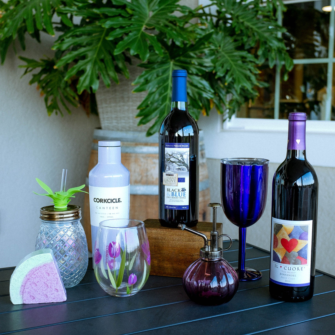 Island Grove Black and Blueberry wine, miscelaneous purple merch, corkcicle, and Il Cuore wine - available for purchase in retail!