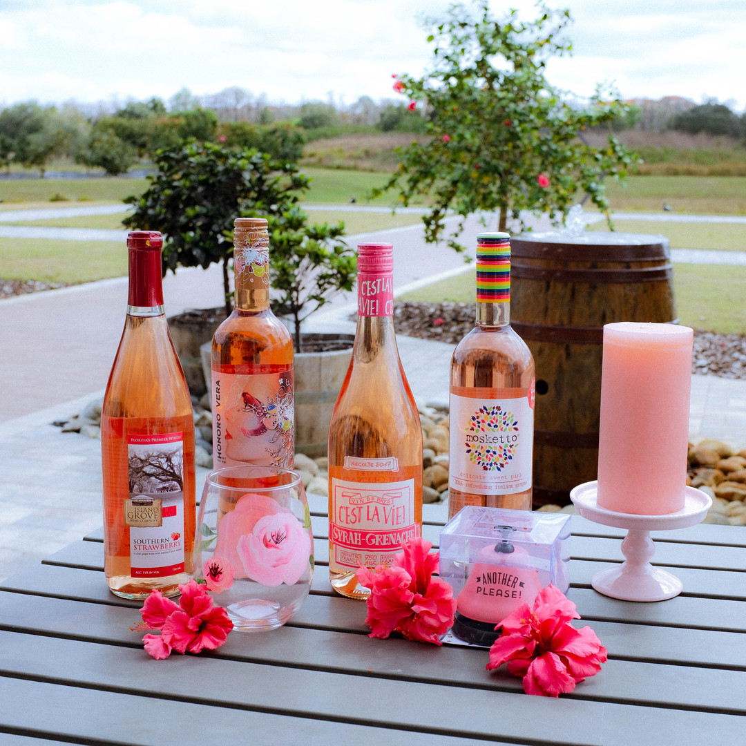 A variety of pink wines that can be purchased at our winery including; our Island Grove Southern Strawberry wine, Honoro Vera, Mosketto, and Vin de Pays C'est La Vie!