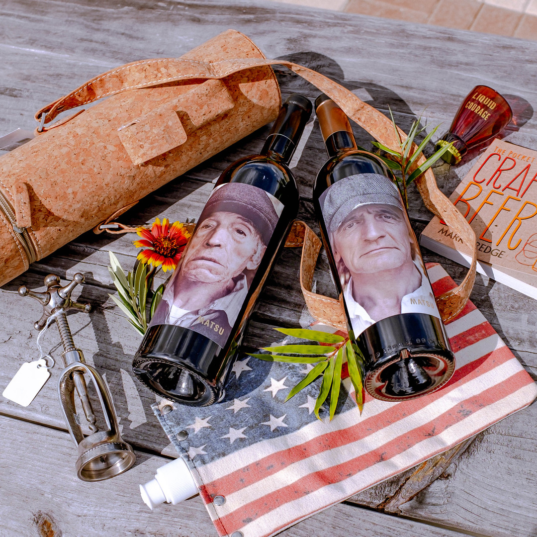 2 bottles of Natsu wine, a unique wine bottle opener, a beer glass shot glass, craft beer book, canteen bag, and wine bottle carrier; all available for purchase in retail.
