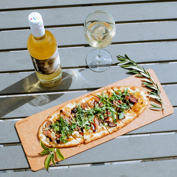 Fig and feta flatbread and a bottle of Honoro Vera Rueda - available for purchase in retail