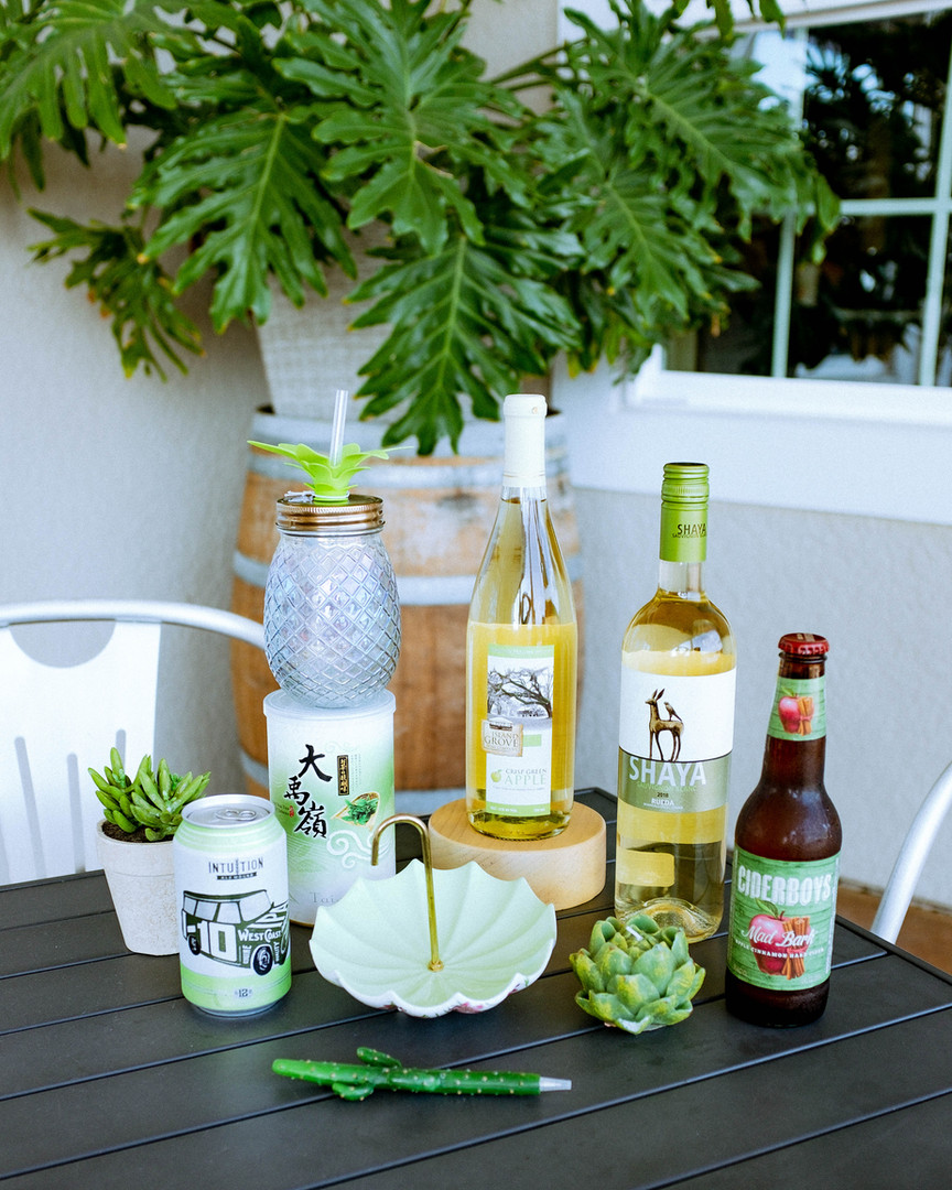 Crisp Green Apple Island Grove Wine along with local craft beers, tea, Shaya wine, and misc. green merchandise available for purchase in retail.