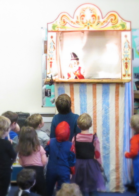 Children entranced by puppets