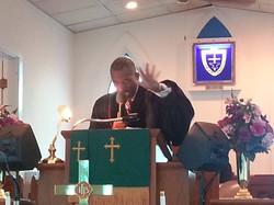 Pastor Young Praying