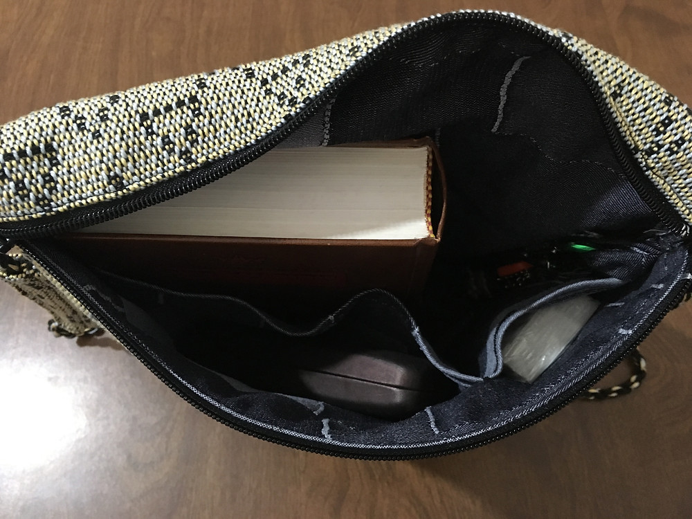 Siddur, keys, tissues and glasses all in easy reach