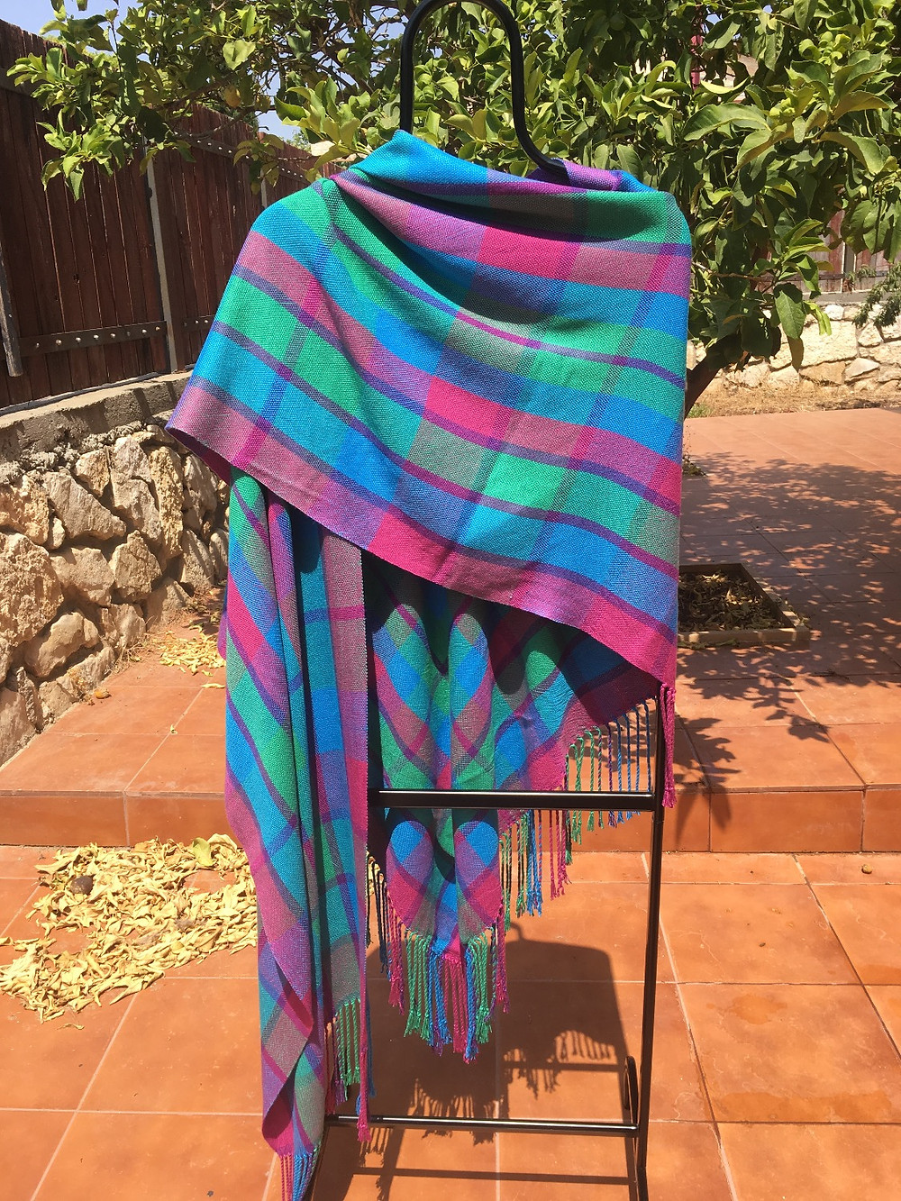 Front of shawl with one side over shoulder.