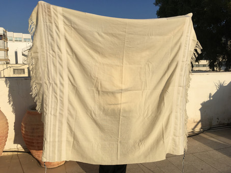 The completed white-striped Tallit