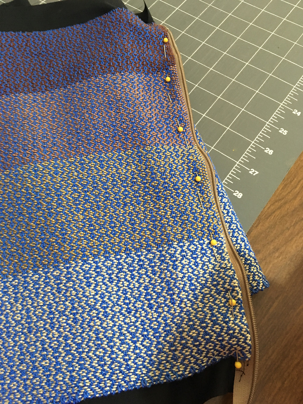 sewing the fabric and lining down to avoid sticking in zipper