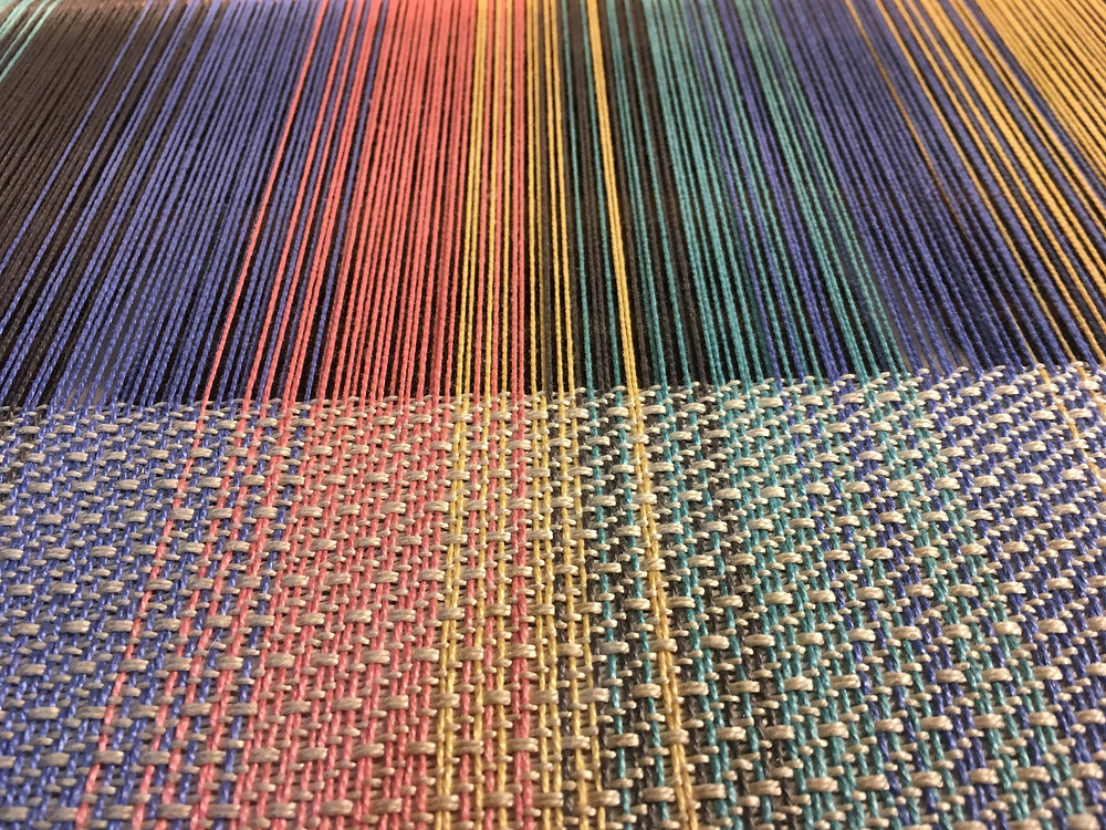 Pattern being woven in a single color.