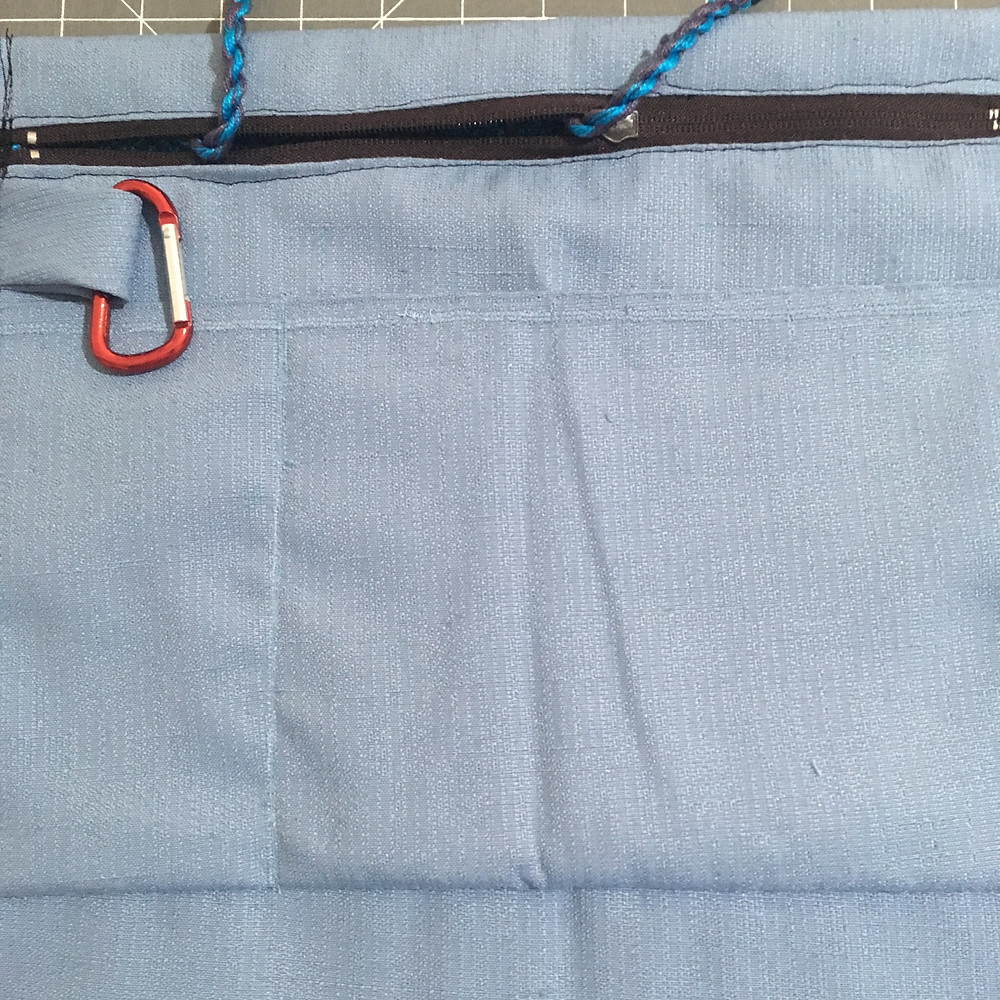 Inside pockets and Carabiner Clip with fabric loop