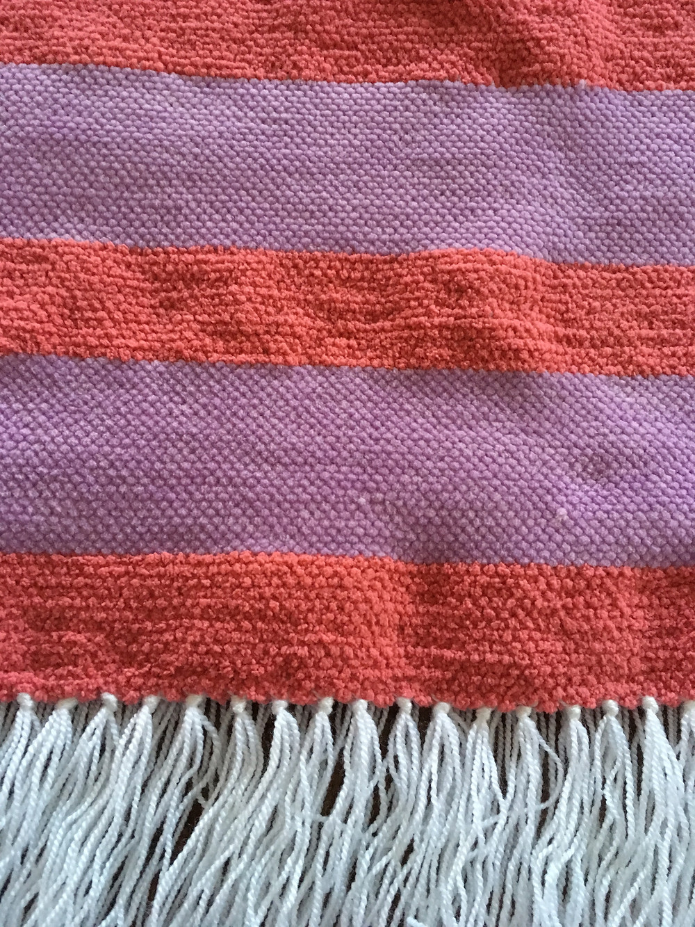 Close up of stripes and fringe on Baby Blanket