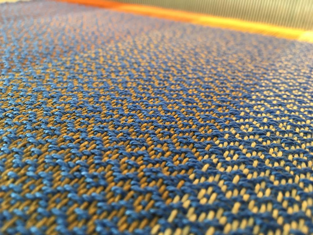 weaving fabric on the loom