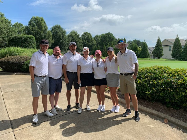 Salesforce Recruiting team with men and women. Posing together before a game of golf in Raleigh, North carolina.