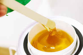 Hot wax in white bowl for hair removal.jpg