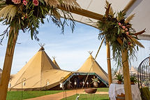 Tipis from entrance with magical walkway