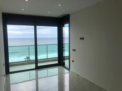 Апартаменты 1+1 на первой линии моря - прямой панорамный вид!