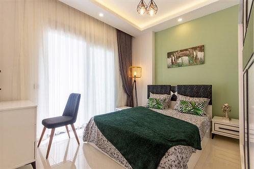 Новые меблированные апартаменты 1+1 в Махмутларе