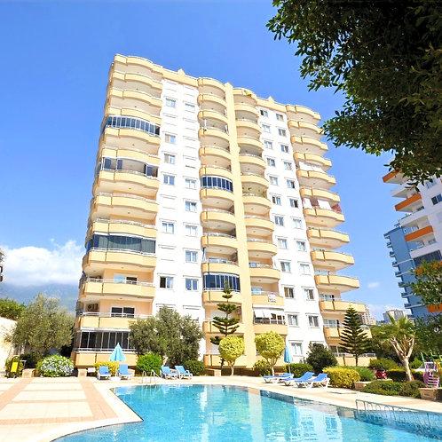 Апартаменты 2+1 в комплексе с  обширной зелёной территорией (Махмутлар)