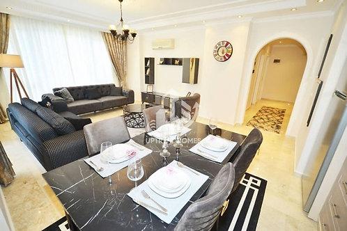 Меблированные апартаменты 2+1 в Махмутларе: большой бассейн, тихий район