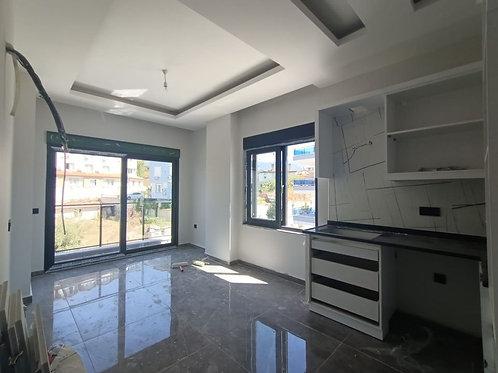 Новые апартаменты 1+1 в Обе от застройщика