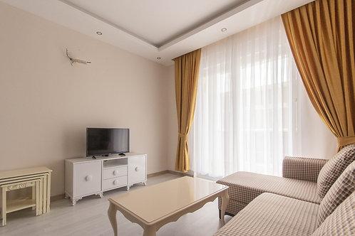 Просторные меблированные апартаменты 1+1 в Махмутларе