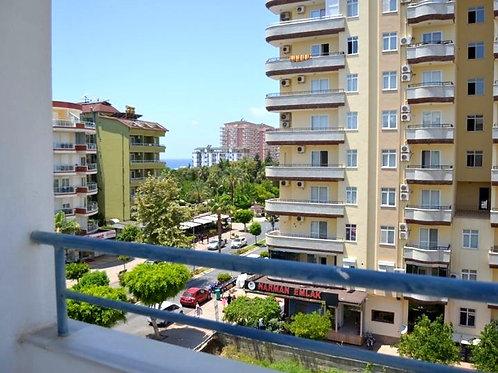 Меблированная квартира 1+1 в парковой зоне Махмутлара (150 м до моря!)