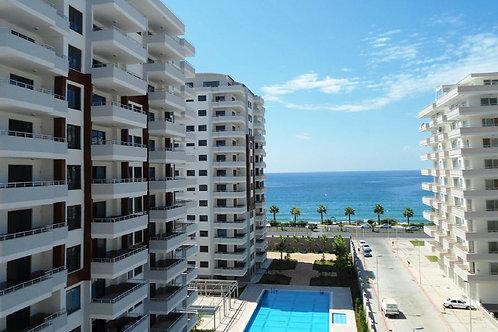 Новые апартаменты 2+1 на 1 линии моря (Махмутлар)