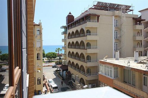 Новые апартаменты 2+1 у пляжа в центре Аланьи (50 м до пляжа!)