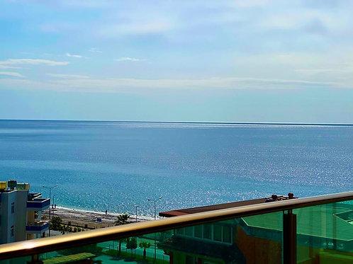 Новые апартаменты 2+1 на первой линии моря (Махмутлар)