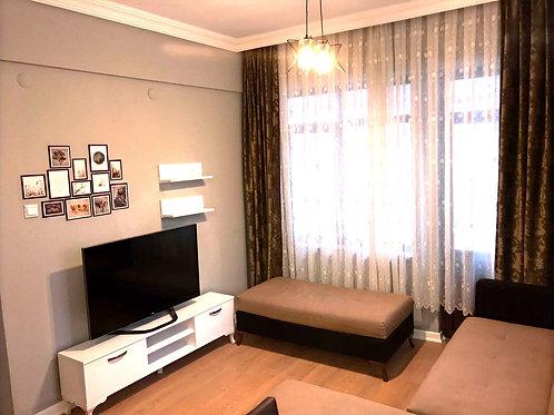 Меблированные апартаменты 1+1 в 50 м от пляжа (Тосмур)
