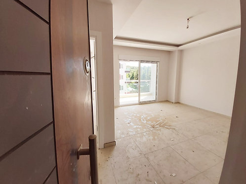 Новые апартаменты 1+1 в Обе (район колледжа Бахчешехир)