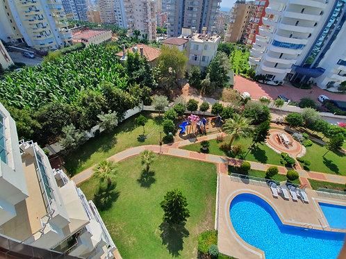 Новые апартаменты 1+1 с красивым панорамным видом (Махмутлар)