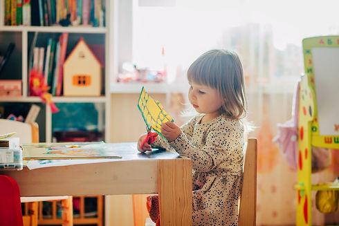 Canva - Little Girl Using Scissors.jpg