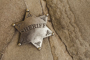 Sheriff badge on natural stone backgroun