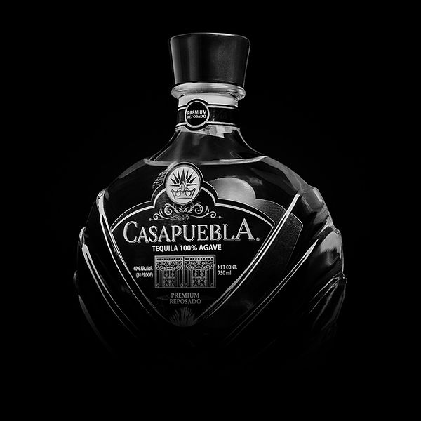 Black and white photo of CasaPuebla Tequila bottle