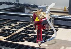 Laser machine cuts plywood close up. Ind