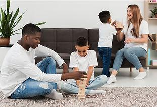 Family playing Jenga