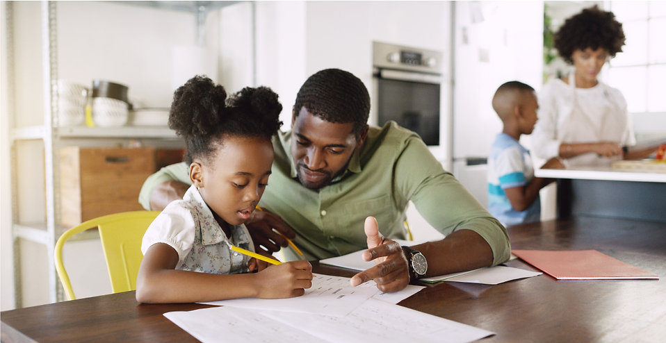 Father homeschooling his child during pandemic