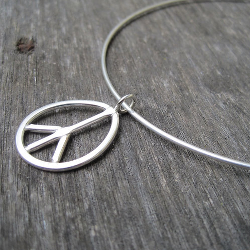 Peace sign pendant on wire