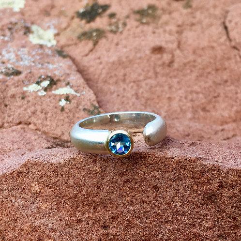 Blue Topaz ring on brushed band