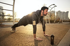 man-in-gray-jacket-doing-push-ups-during