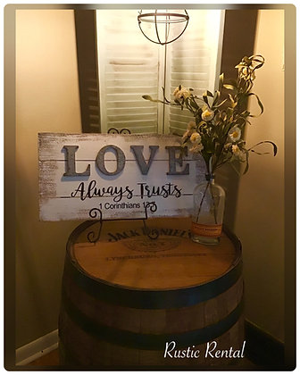 """Love always trusts"" sign and easel"