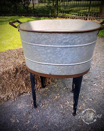 Galvanized bucket on stand