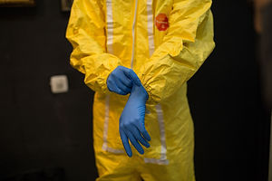 Scientist or inventor wears decontaminat