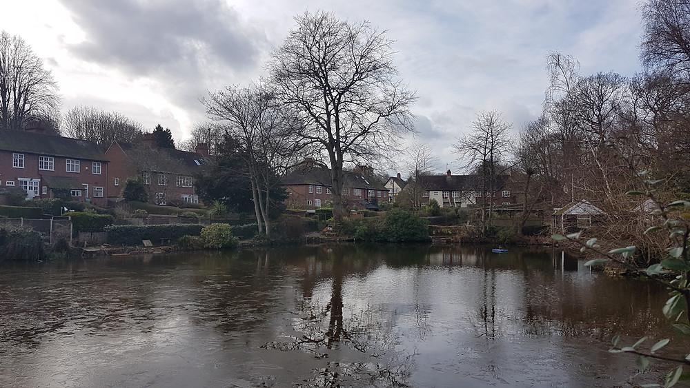A partially frozen Moor Pool pond