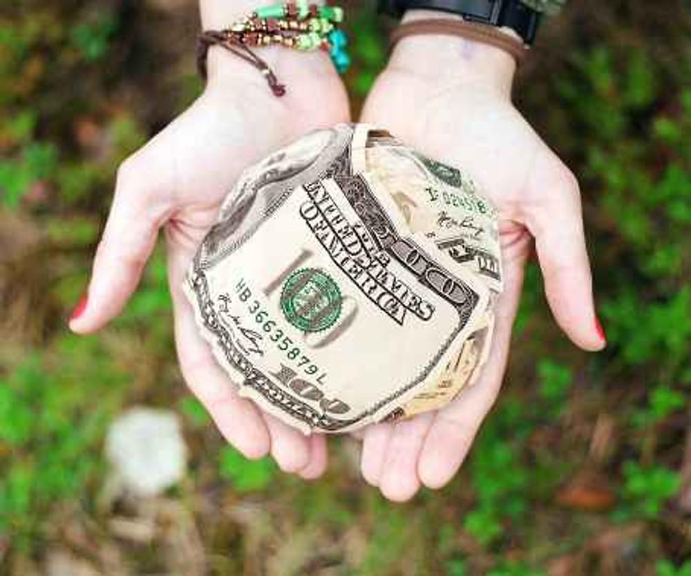 cash dollars hands money