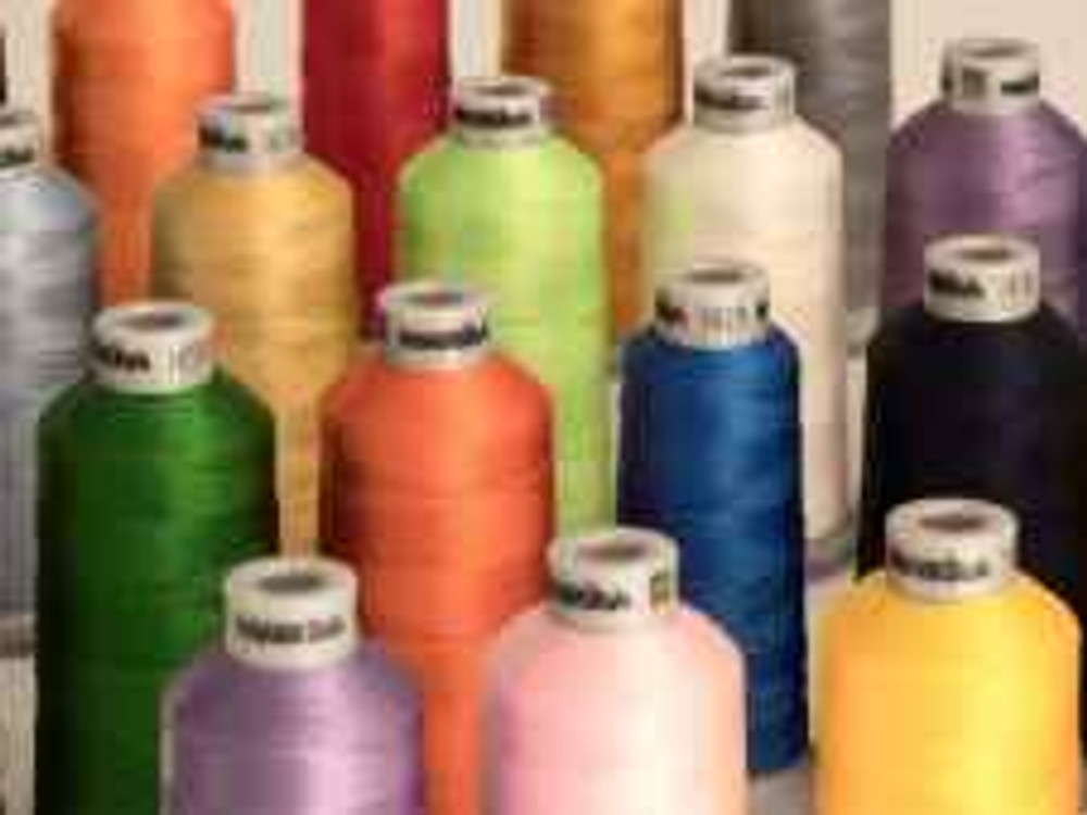 assorted color threads on white surface